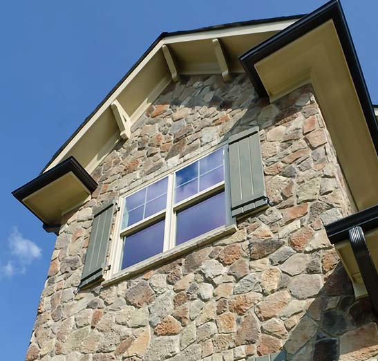 Brandon Florida Home Insurance, image looking up to a stone wall exterior residential home.