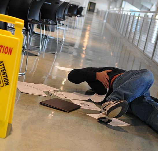 Worker slips and falls in a commercial office area